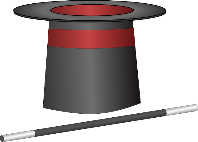 kreslený kouzelnický klobouk a hůlka